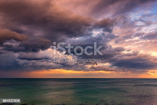 Exciting sunset. Beautiful colorful clouds over the sea.