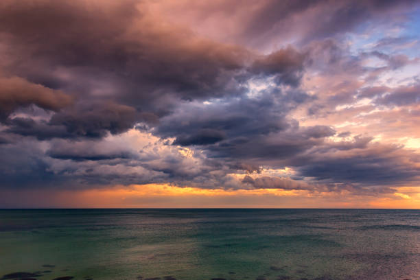 Exciting sunset Exciting sunset. Beautiful colorful clouds over the sea. atmospheric mood stock pictures, royalty-free photos & images