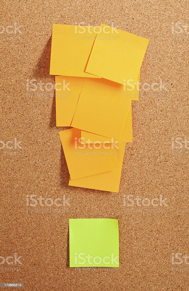 Exclamation mark from stickers on cork board royalty-free stock photo