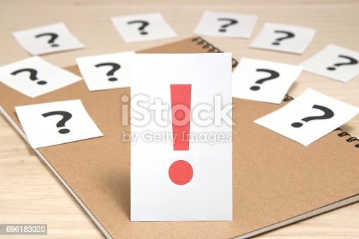 1048039800 istock photo Exclamation mark in front of many question marks. 696183020