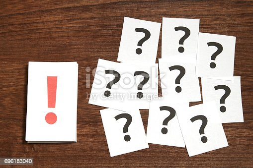 1048039800 istock photo Exclamation mark in front of many question marks. 696183040
