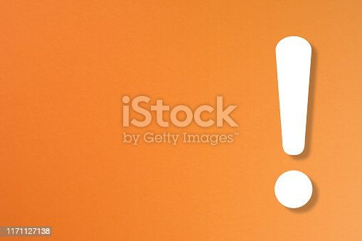 istock Exclamation mark on orange background 1171127138