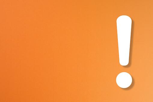 istock Exclamation mark on orange background 1171127138