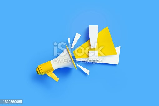 Exclamation point coming out from a yellow megaphone on blue background. Horizontal composition with copy space. Great use for alertness and warning concepts.