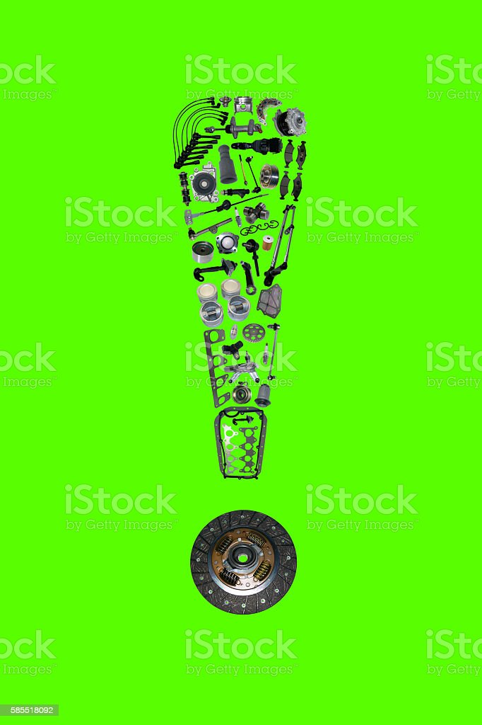 Exclamation point with auto parts for car stock photo