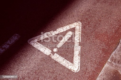 istock exclamation sign on the asphalt road (red toned, concept of danger) 1059908914