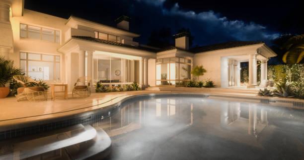 Exclusive Luxury Villa with Swimming Pool (Night) stock photo
