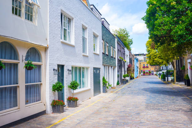 Exclusive mews with colored luxury residential houses in Marylebone, a weatlhy borough of central London Exclusive mews with colored luxury residential houses in Marylebone, a weatlhy borough of central London mayfair stock pictures, royalty-free photos & images