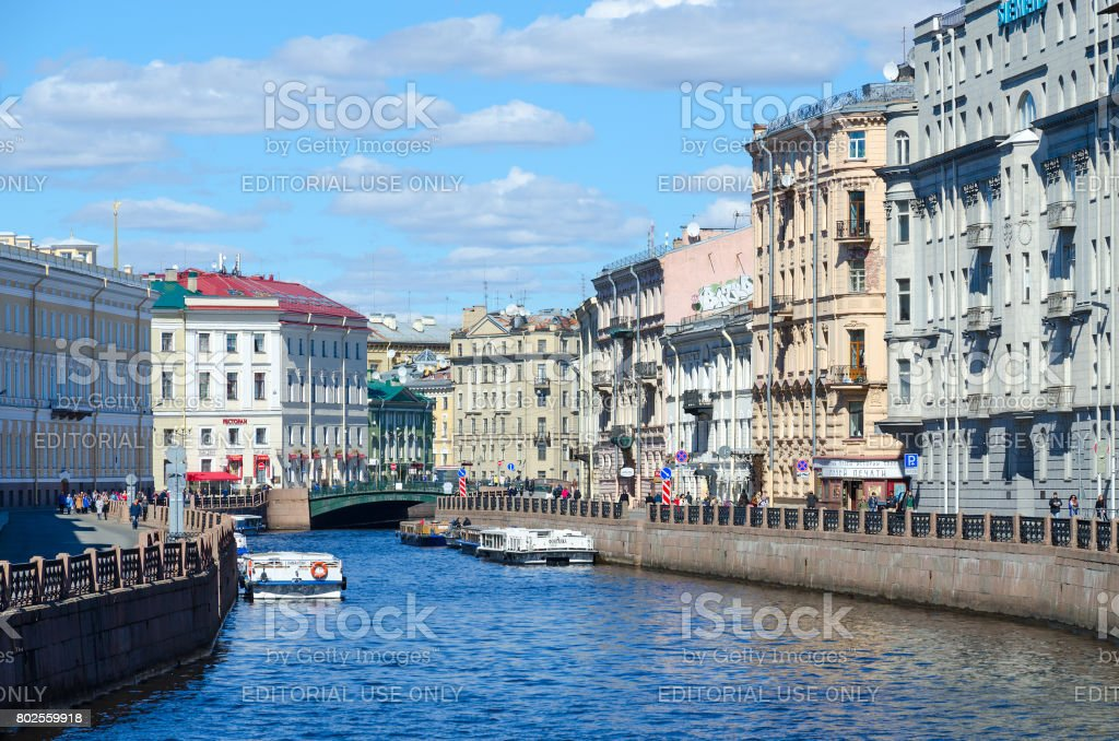 Excursion boats on Moika River near Green Bridge, St. Petersburg, Russia stock photo