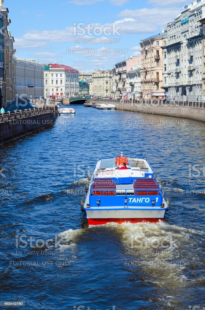 Excursion ships on Moika River near Green Bridge in St. Petersburg, Russia stock photo