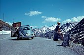 South Tyrol, Italy, 1966. A traveler enjoys the view on an alpine pass.