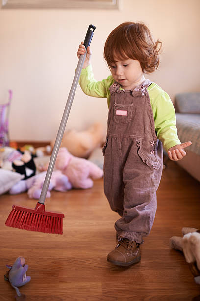 Excuse the mess, I'm busy making memories Shot of a cute little girl playing with a broom at homehttp://195.154.178.81/DATA/i_collage/pu/shoots/805004.jpg kids cleaning up toys stock pictures, royalty-free photos & images