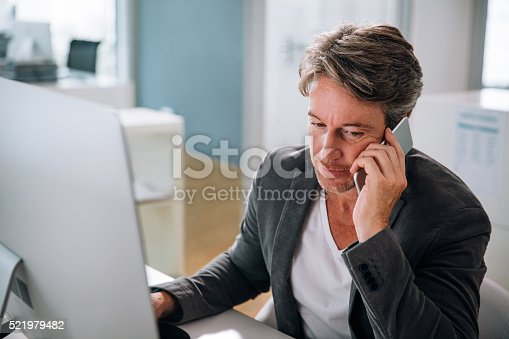 513583458 istock photo Executive business man having conversation on smartphone 521979482