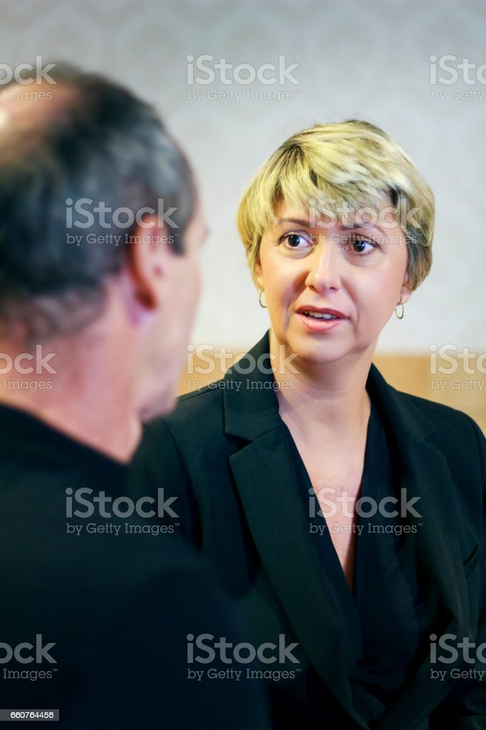 Executive business woman talking with business man stock photo