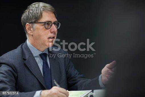 637940820 istock photo Executive businessman talking in meeting 637932514