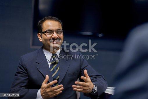 637940820 istock photo Executive businessman talking in meeting room 637933278