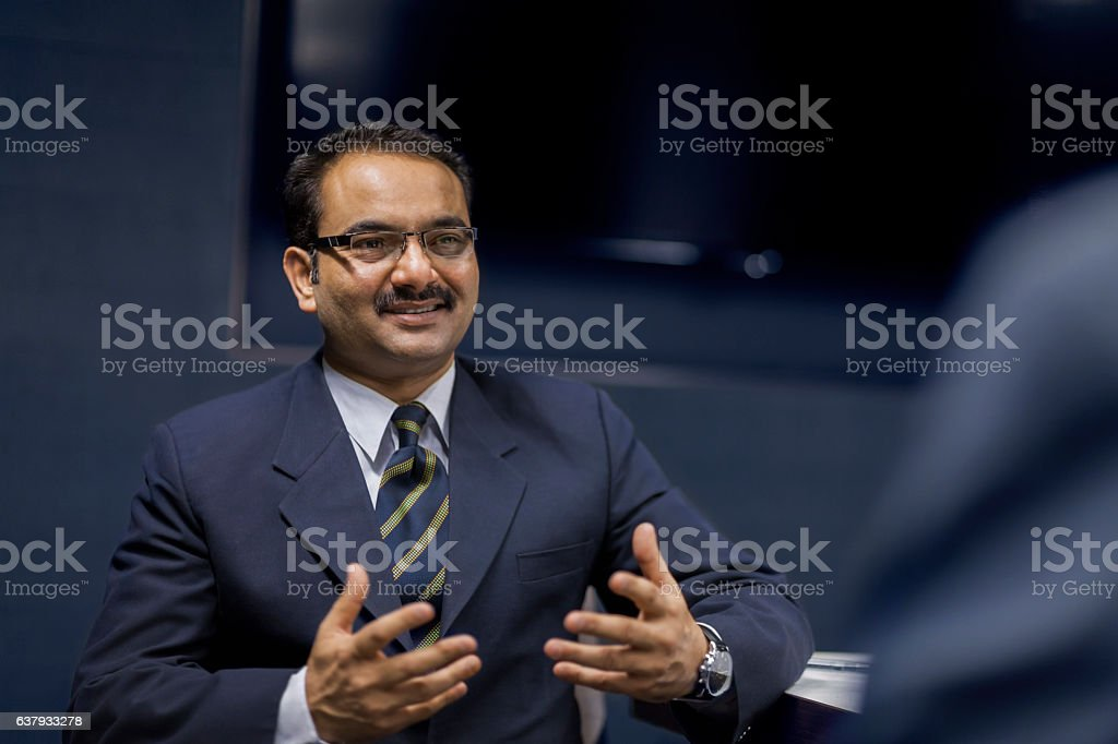 Executive businessman talking in meeting room stock photo