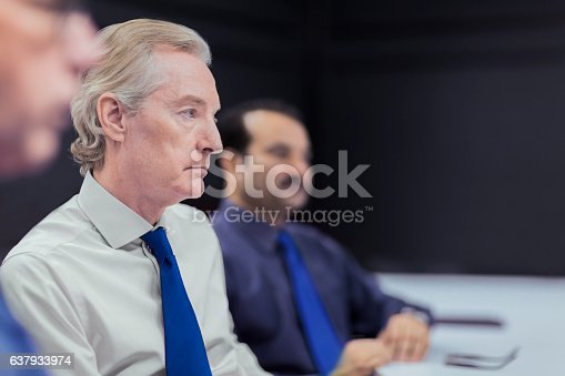 637940820 istock photo Executive businessmen in office meeting 637933974