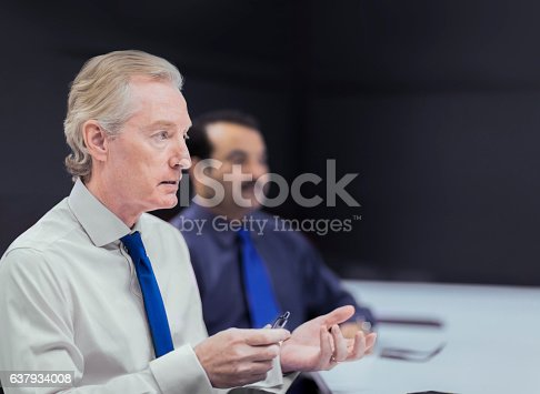 637940820 istock photo Executive businessmen in office meeting 637934008