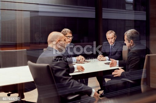 istock Executive businessmen talking in meeting room 637933212
