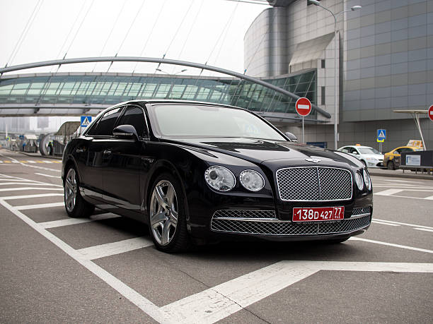 Executive car Bentley Flying Spur with diplomatic plates stock photo