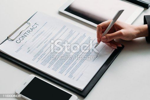 Executive decision. Business woman making a deal with partners. Closeup of female hand signing contract.