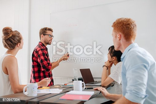 812513444istockphoto Executive explaining business plans to his coworkers 610947004