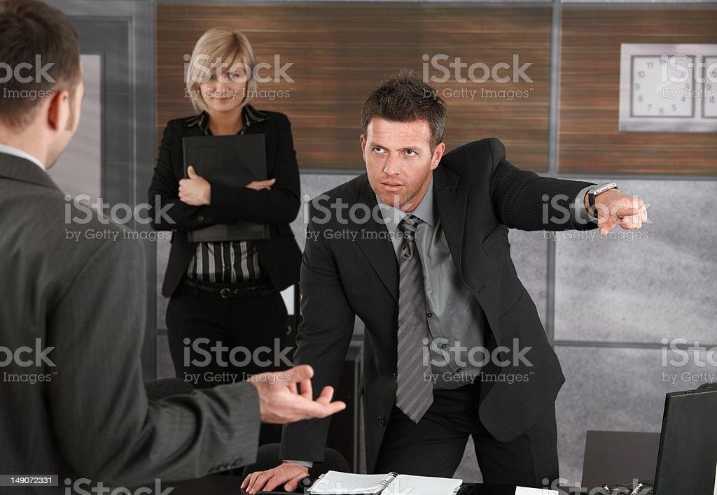 Executive firing employee royalty-free stock photo
