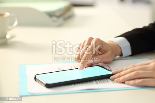 Executive hand signing digital contract on phone