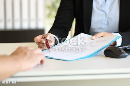 istock Executive hands indicating where to sign contract 638881988