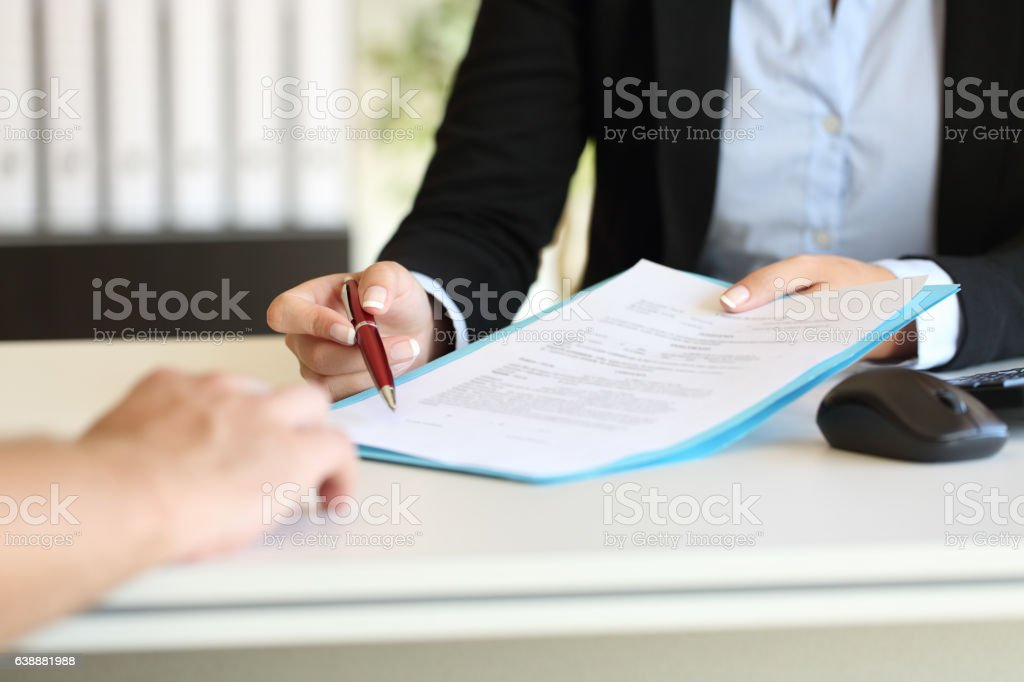 Executive hands indicating where to sign contract - foto de stock