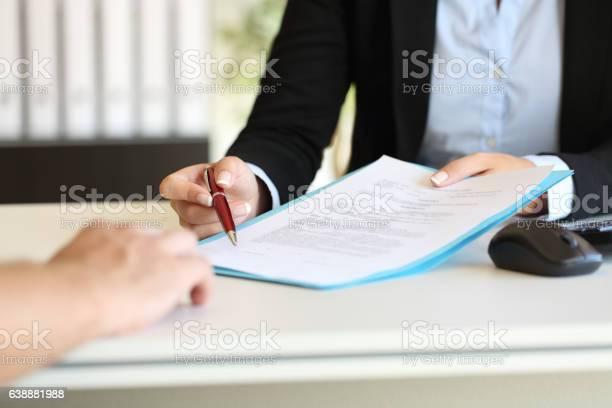 Executive Hands Indicating Where To Sign Contract - Fotografie stock e altre immagini di Accordo d'intesa