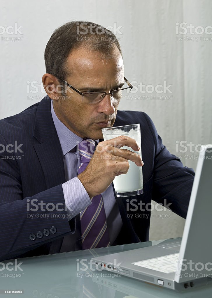 Executive having a drink in wi fi area royalty-free stock photo