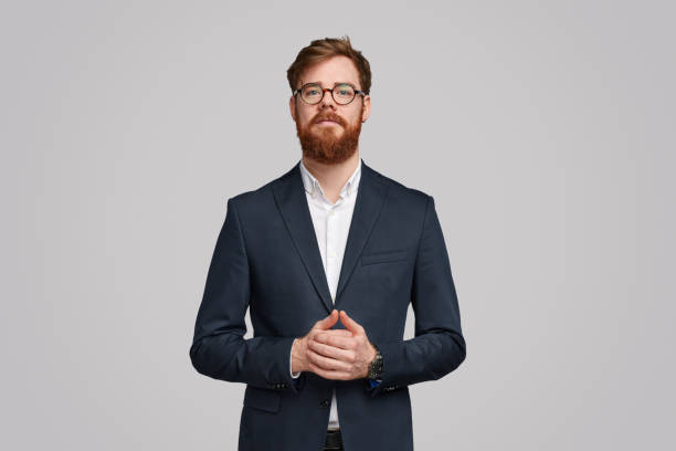 Executive man in trendy suit looking at camera stock photo