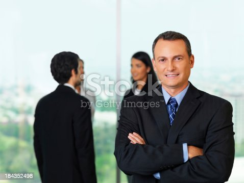 istock Executive man with his team 184352498