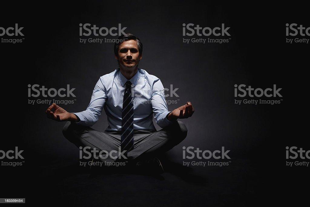 Executive meditating royalty-free stock photo