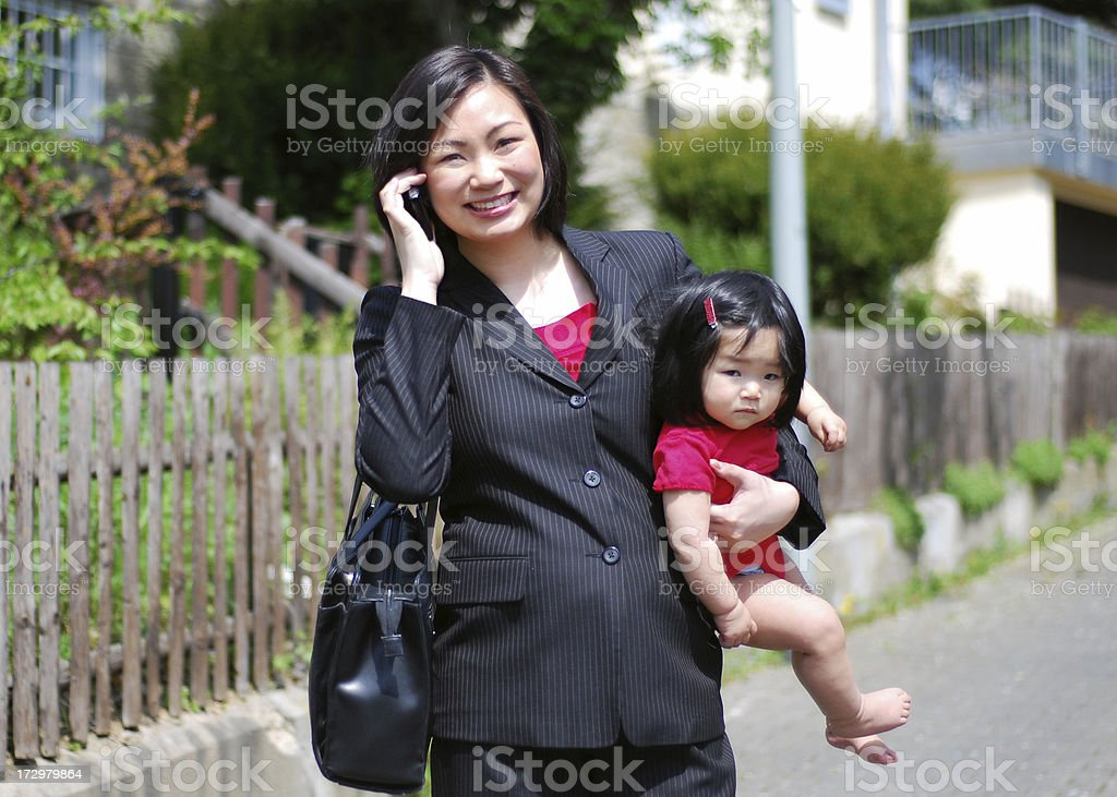 Executive mother on the phone royalty-free stock photo