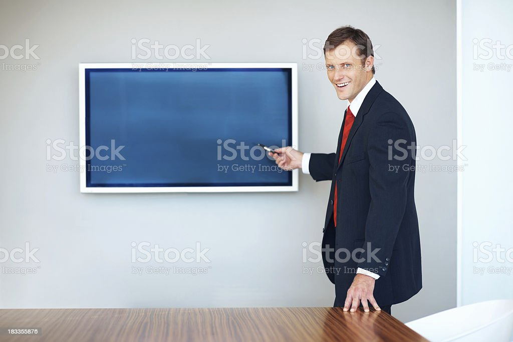 Executive pointing at presentation on the screen royalty-free stock photo