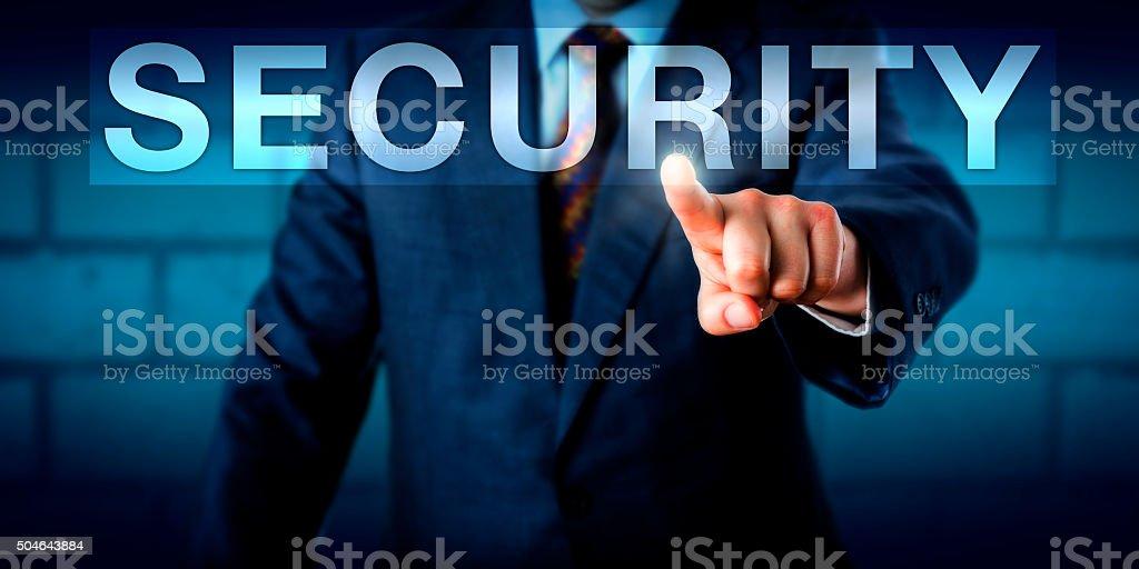 Executive Pressing SECURITY Button Onscreen stock photo