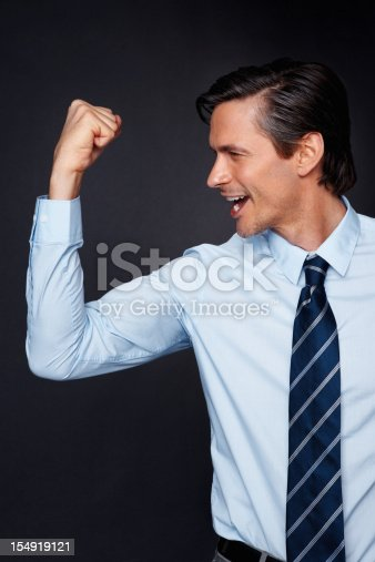 465474428 istock photo Executive pumping fist with exhilaration 154919121