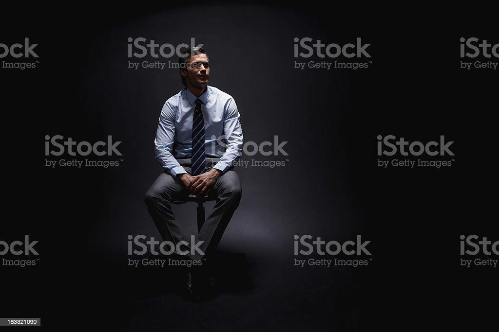 Executive sitting and reflecting royalty-free stock photo