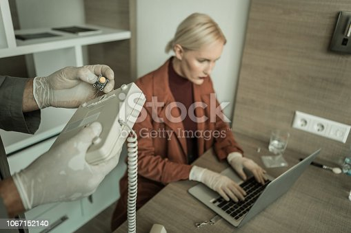 istock Executive spy setting up chip inside of phone 1067152140
