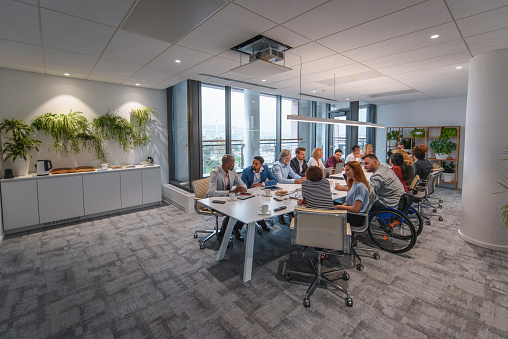660681964 istock photo Executive Team Sitting at Conference Table in Board Room 1183053315