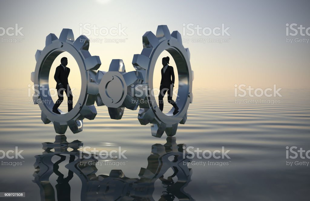 Executive team walking inside gears at sea since dawn. stock photo