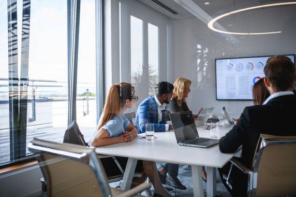 Executive Team Watching Video in Office Conference Room stock photo