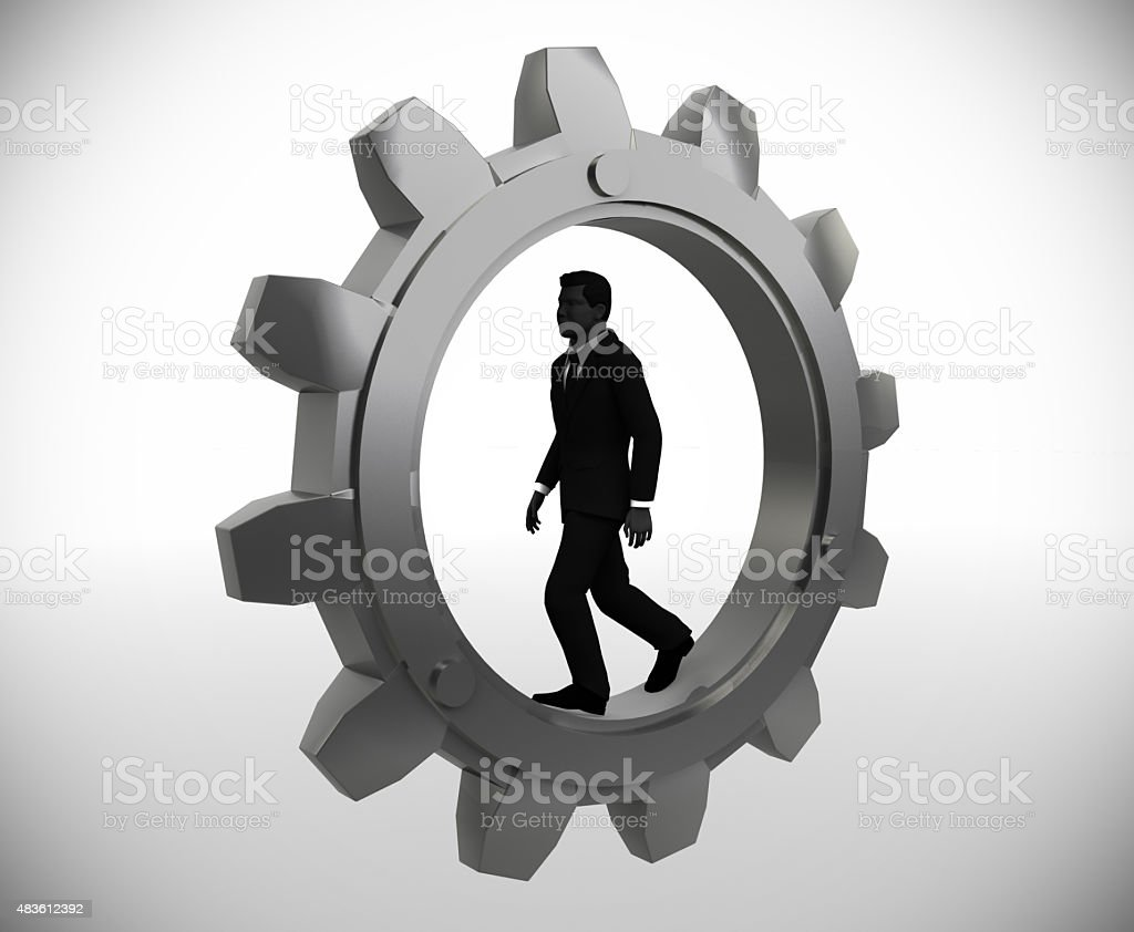 Executive walking inside a gear. stock photo