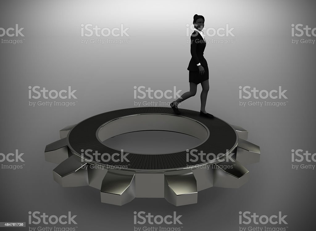 Executive walking on top of a gear stock photo