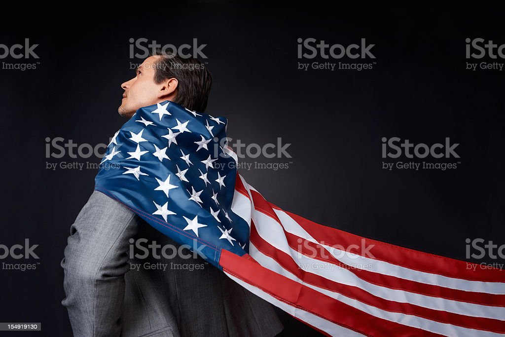 Executive wearing American flag as cape royalty-free stock photo