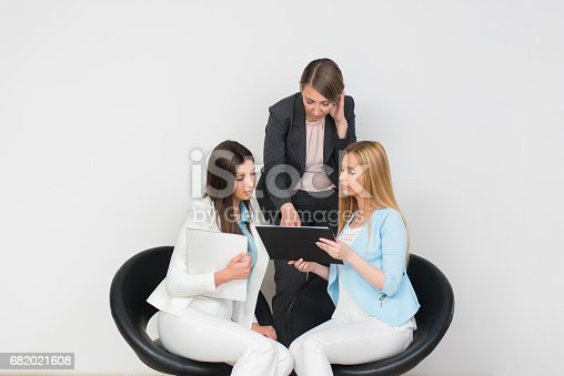995734014istockphoto Executive with employees in office, giving advice 682021608