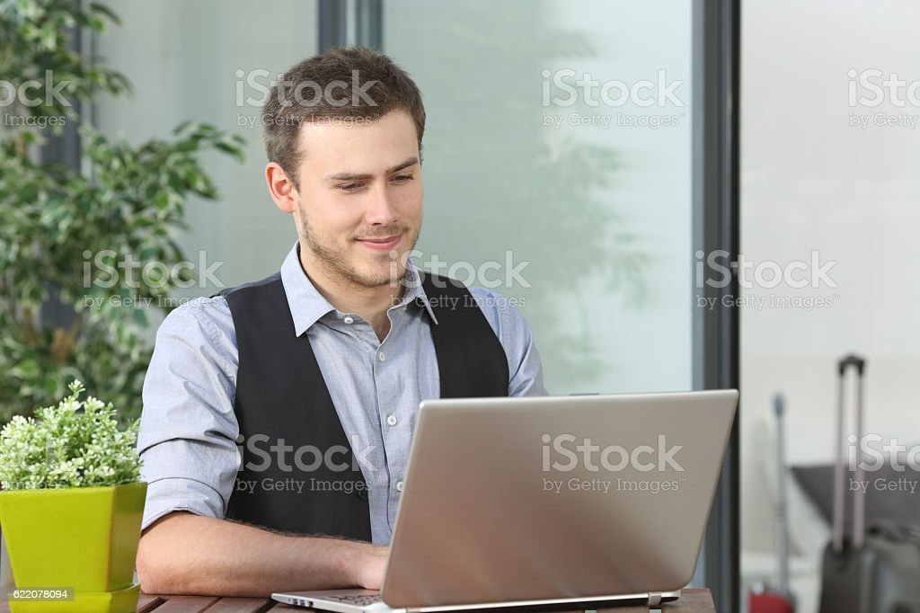 Executive working in an hotel during business travel stock photo